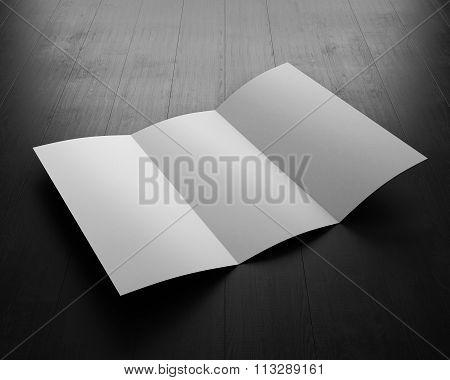 Opened Booklet On Black Board. 3D Illustration. Blank Booklet For Your Design.