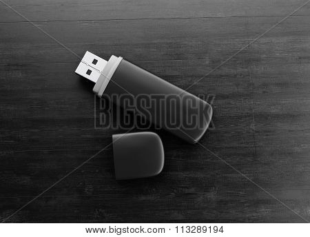 Black Usb Drive On A Black Wooden Background. 3D.