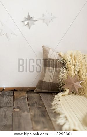 Pillow And Plaid On Wooden Boards.