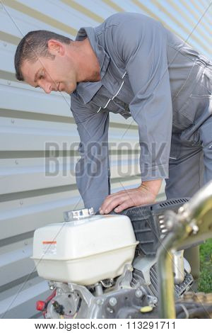 Man poised to start generator