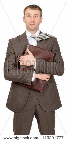 Smiling businessman hugging suitcase