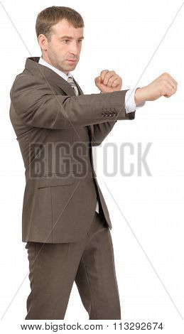 Serious businessman as succesful fighter