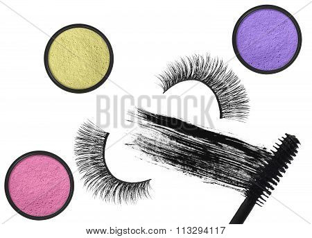 Stroke (sample) Of Black Mascara, Eyeshadows And False Eyelash Isolated On White Macro