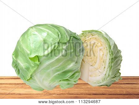 Fresh Tasty Cabbage On Wooden Table Isolated On White