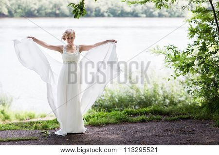 Happy Bride In A Wedding Dress Is Spinning.