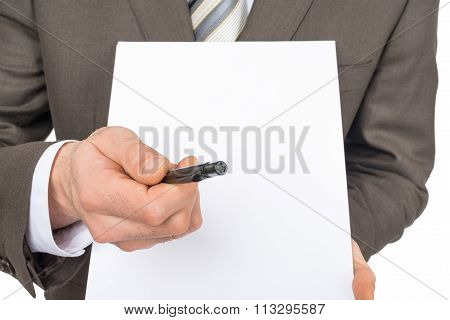 Businessman offering to sign up blank paper