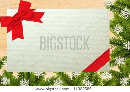 Old Wood Board With Green Christmas Tree Branch And Greeting Card