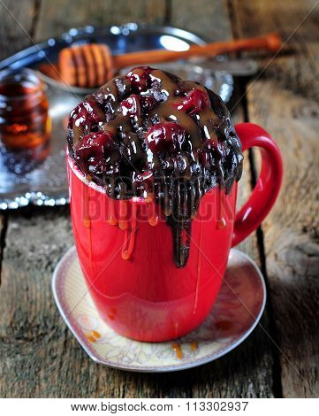 Delicious Mug Cake, chocolate cherry cake cooked in a cup in the microwave