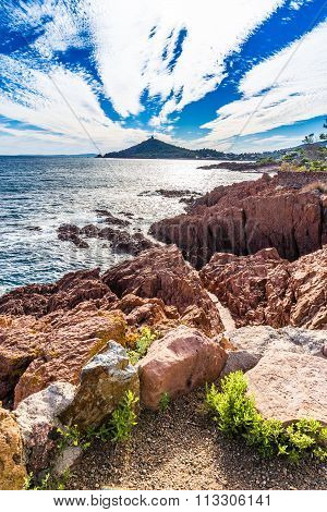 Red rocks of Esterel Massif and Dramont Cape in the late afternoon summer light-French Riviera Provence-Alpes Cote d'Azur France