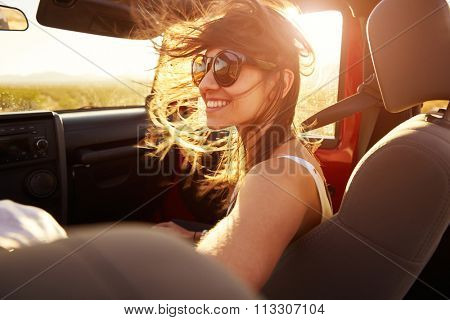 Woman Passenger On Road Trip In Convertible Car