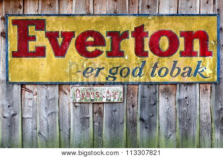 Old advertising of Everton Tobacco on a wooden wall