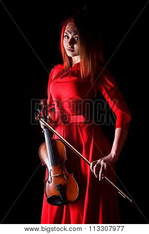 Pretty Young Woman Holding A Violin