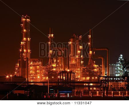 landscape of oil refinery factory and distillation tower at night