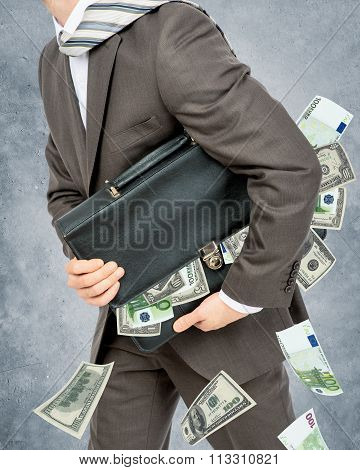Businessman holding suitcase with cash
