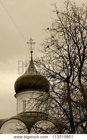 Orthodox Cross On A Background Of The Gray Autumn Sky.