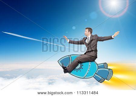 Businessman flying on rocket
