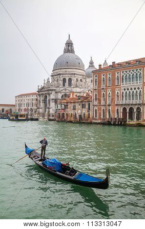 Gondola At Grand Canal In Front Of Basilica Di Santa Maria Della Salute