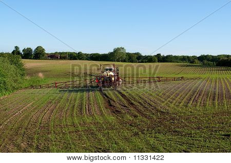 Farmer spraying his fields with pesticide