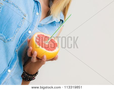 Summer. Grapefruit With Drinking Straw In Hand
