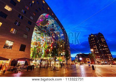 modern market hall in Rotterdam, Netherlands, at night
