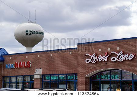 Shorewood Water Tower Seen Above a Strip Mall