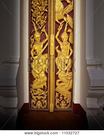 Golden Buddhist Temple Door At Wat Phoechai, Loa.