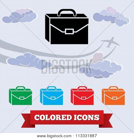 Baggage icon. Hand luggage, traveling symbol. Black, red, green, blue, orange colored signs on light