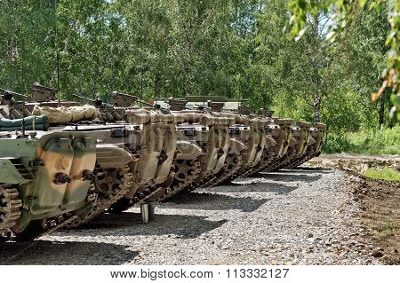 Tanks Built In A Row On The Ground