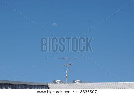 Tv Antenna With The Moon In The Day Time