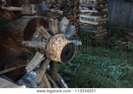 wooden wheel carts with broken spokes