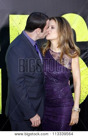 LOS ANGELES, CALIFORNIA - June 25, 2012. John Travolta and Kelly Preston at the Los Angeles premiere of 'Savages' held at the Mann Village Theatre, Los Angeles.