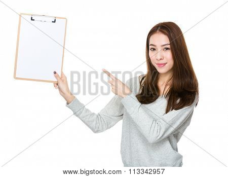 Young woman finger point to clipboard