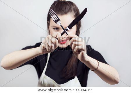 A Pretty Cute Young Woman Holding Kitchen Utensils
