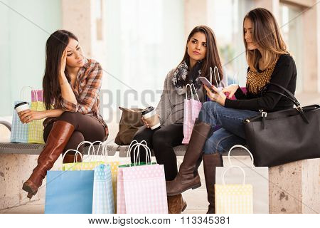 Group Of Women Tired Of Shopping In A Mall
