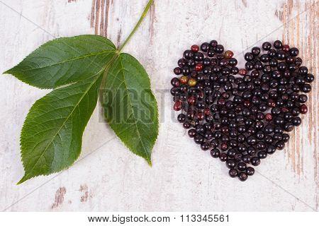 Heart Of Elderberry On Old Wooden Background, Symbol Of Love