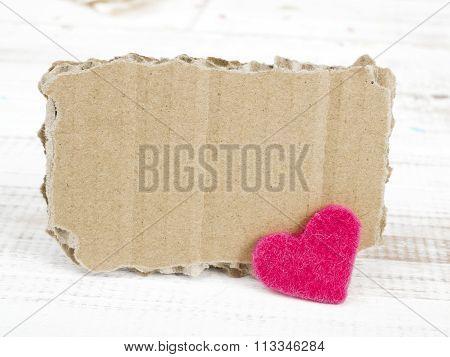cardboard plaque and felt heart