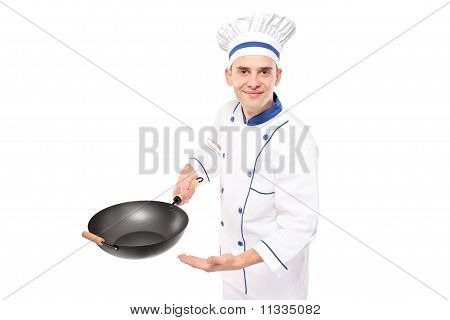 Chef Holding A Wok Welcoming