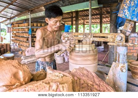 Skillful hands potter at work shaping ceramic products