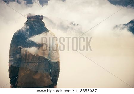 Double Exposure of Man and Cloudy Mountains forest Travel Lifestyle