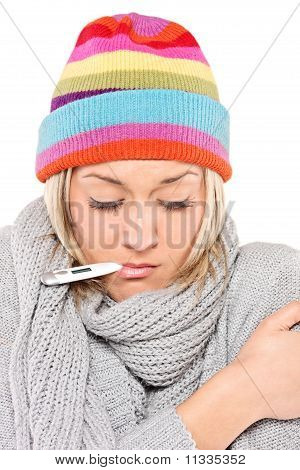 Ill Woman Wearing A Cap And Scarf With Thermometer In Her Mouth