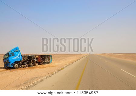 Broken lorry on the side of the street in the desert