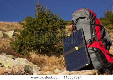 The solar panel on the backpack.