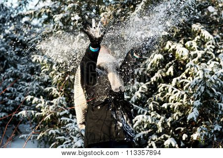Teenage woman is defending herself from snowball