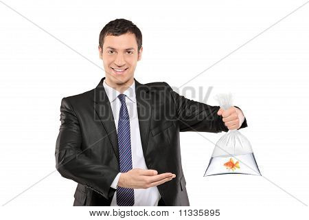 A Smiling Man Showing A Plastic Bag With Golden Fish