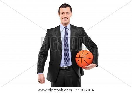 Smiling Businessman Holding A Basketball