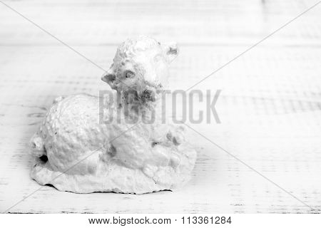 sheep figure on a white planks