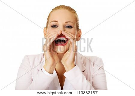Young smiling business woman screaming loud or calling someone.
