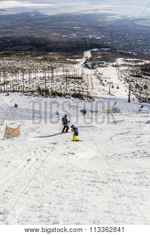 Child Descend On Skis For Father.