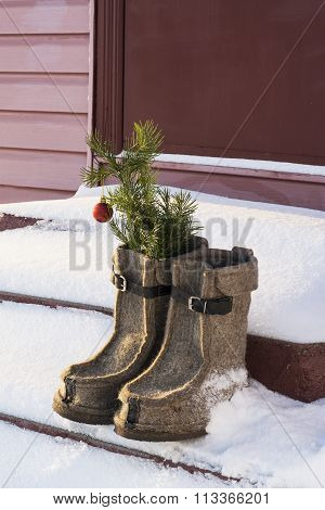 Christmas Decoration with felt boots, fir's branches and christmas