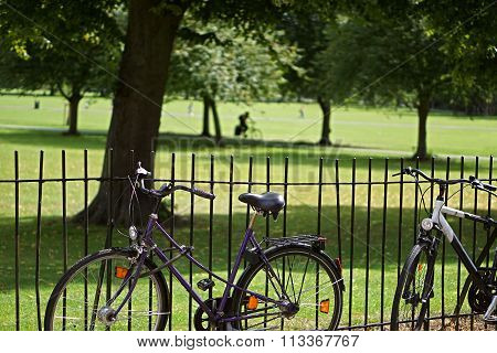 Bikes And Cyclist On Jesus Green, Cambridge, England